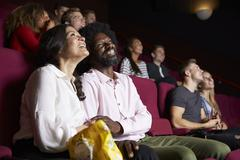 Couple In Cinema Watching Comedy Film Stock Photos