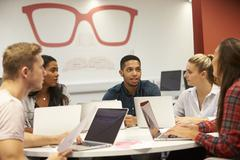 Group Of University Students Collaborating On Project Stock Photos