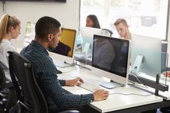 Group Of University Students Using Online Resources Stock Photos