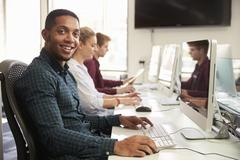 Portrait Of Male University Student Using Online Resources Stock Photos