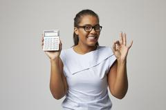 Studio Portrait Of Female Accountant Using Calculator Stock Photos