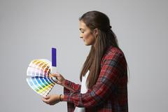 Studio Shot Of Female Graphic Designer With Color Swatches Stock Photos