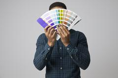 Studio Portrait Of Graphic Designer With Color Swatches Stock Photos