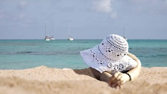 Woman with big hat sunbath relax beach, turquoise tropical sea, exotic holiday Stock Footage