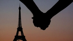 Couple lovers holding hands in Paris at sunset, Eiffel Tower in background Stock Footage