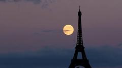 Moon rise behind Eiffel Tower Paris Stock Footage