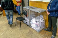 Urns with ballot papers in polling station on election day in the State Duma Stock Photos