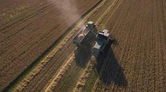 Aerial View As Tractor Collects Wheat From Combine Harvester Kuvituskuvat