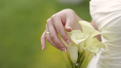 Bride holding her wedding bouquet of callas Stock Footage