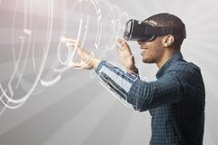 Man Using Virtual Reality Headset Stock Photos