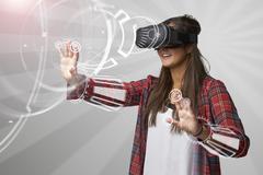 Woman Using Virtual Reality Headset Stock Photos