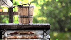 Wooden bucket on well rustic traditional fountain, source of pure water Stock Footage