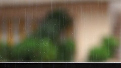 Detail of raindrops falling on balcony balustrade and splashes water on slow Stock Footage