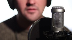 Close up man singing into a condenser microphone Stock Footage