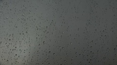 Close up image of rain drops falling on a window , ULTRAHD 4k, real time Stock Footage