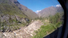 PASSENGER TRAIN VIEW Urubamba River Willkamayu TO MACHU PICCHU Stock Footage
