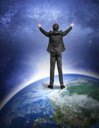 Man standing on the Earth planet. Stock Photos