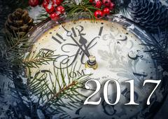 Two thousand and seventeen New Year still life. Old clock on snow. Stock Photos
