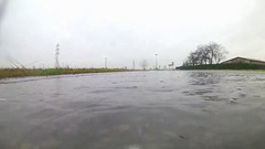 A big puddle and a car Stock Footage