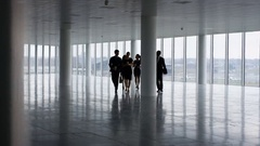 4K Business team viewing empty commercial property & shaking hands with agents Stock Footage