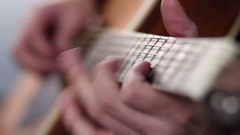 Man's fingers playing on guitar frets Stock Footage
