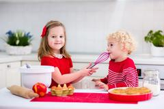 Kids baking apple pie Stock Photos