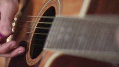 Male musician playing on acoustic guitar Stock Footage