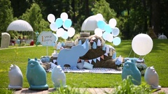 Meadow decorated with baloons, figures of animals and flowers Stock Footage