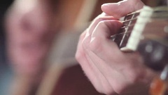 Playing guitar - fingers on fretboard Stock Footage