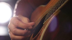 Performing chords on acoustic guitar Stock Footage