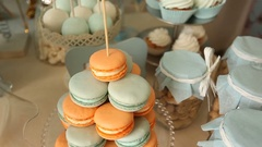 Table with different sweets and jars with peanuts Stock Footage
