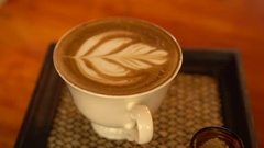 Cup of coffee with beautiful Latte art Stock Footage