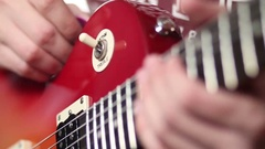 Rock musician with electric guitar fretting chord Stock Footage