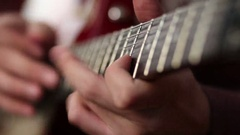 Guitar player using tapping technique Stock Footage