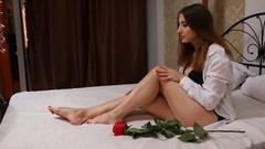Sexy woman stroking leg Stock Footage