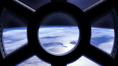 Earth as seen through window of International Space Station ISS, moving to the Stock Footage