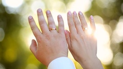 Newlyweds showing their wedding rings Stock Footage
