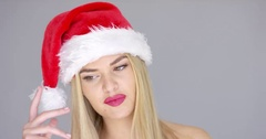 Sensual girl in Santa Claus hat posing isolated on gray Stock Footage