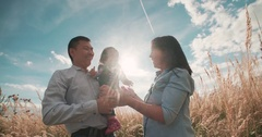 Young Asian family in a field with a baby 1 year on hand, the concept of marital Stock Footage