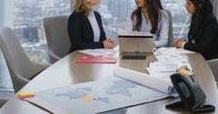 4K International female business team analyzing data in city office Stock Footage