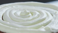 Close-up: biscuit cream in the form of a spiral on the cake Stock Footage