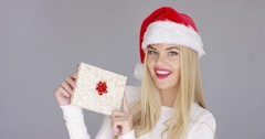 Pretty young girl posing with chrismas present Stock Footage