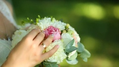 Bride holding her wedding bouquet Stock Footage