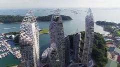Aerial of three skyscrapers near harbor in Singapore City Stock Footage