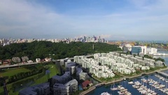 Aerial of buildings and boats moored at harbor in Singapore City Stock Footage