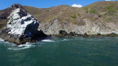 Aerial of rocky cliffs and ocean along the coast of California Stock Footage