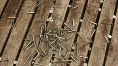 Nails Falling on a Table Medium Closeup Stock Footage