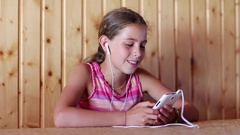 Beautiful girl communicates via smartphone Stock Footage
