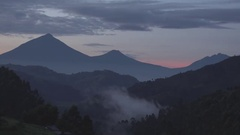 Red sunset behind the mountain's in Uganda. Stock Footage
