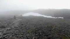 Foggy Navigation Pillars on a Mountain Stock Footage